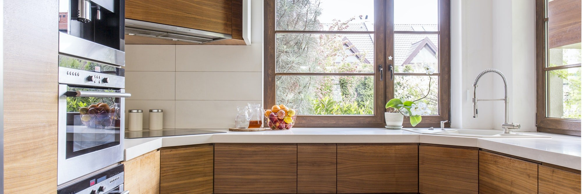 Wooden cupboards in classic kitchen
